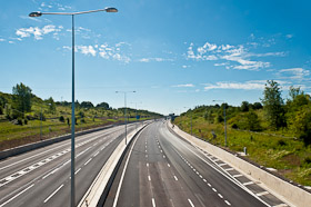A picture of the 8-lane wide M25 motorway, apparently without a single car on the road