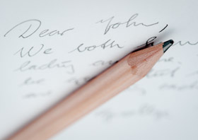 Dear John letter with a worn, rounded pencil on top