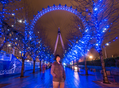 "Picture of the London Eye at night, with the treeline making an ""inverted"" triangle"