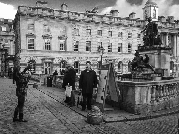 iPhone photographer capturing tourist capturing tourist in front of Somerset House