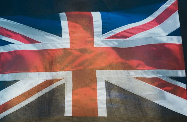 Poster of Union Jack behind shop window