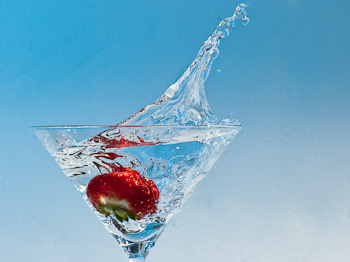 Strawberry splash on blue background