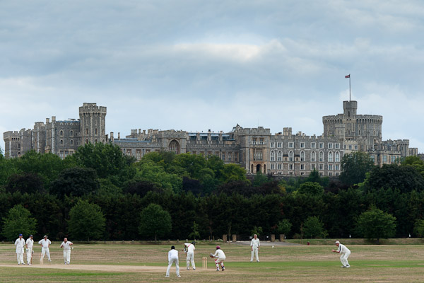Cricketeers playing in front of Windsor Castle