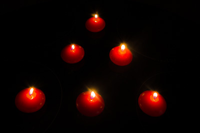 Picture of six red candles arranged in a triangular shape