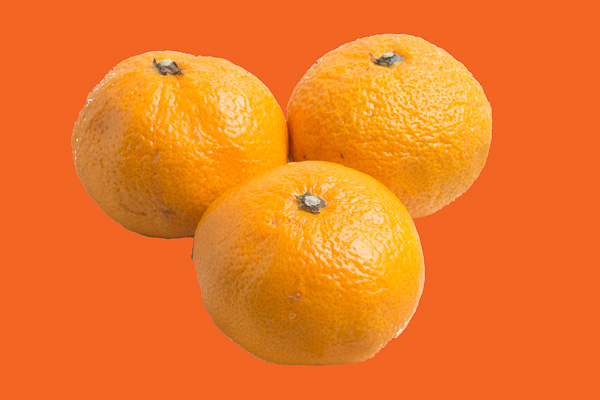 "Orange: The three satsumas from the fruitbowl match the ""pure orange"" background well"
